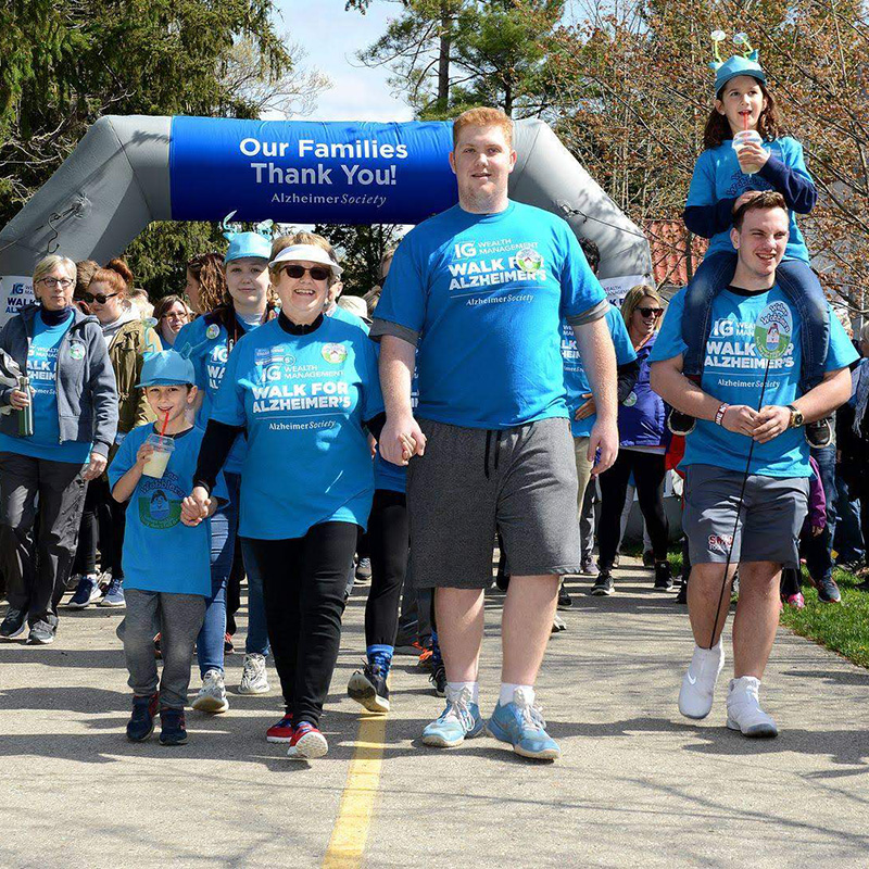 Smiling family members participating in the IG Wealth Management Walk for Alzheimers
